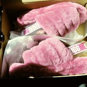 Pink Ugg slides
